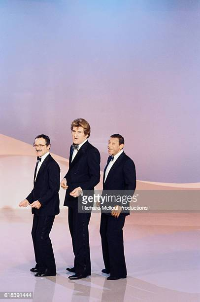 French singers Marcel Zanini Eddy Mitchell and Henri Salvador record a Christmasspecial television show