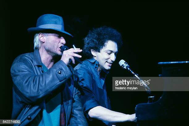 French singers Michel Berger and Johnny Hallyday on stage at Paris Bercy concert hall