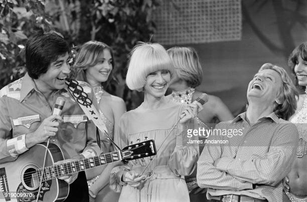 French singers Ringo and Claude François on the set of the french tv show 'Midi Trente' hosted by Danielle Gilbert 20th September 1977