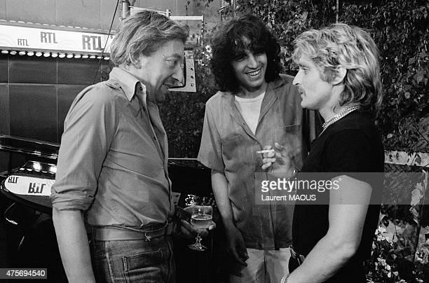French singers Serge Gainsbourg, Julien Clerc and Christophe during a radio show on RTL radio in Paris, France, on June 21, 1978.
