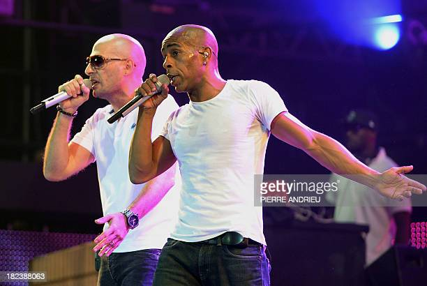 French singers Shurik'n and Akhenaton of French rap band IAM perform on stage during the Urban Peace 3 hiphop concert on September 28 2013 at the...