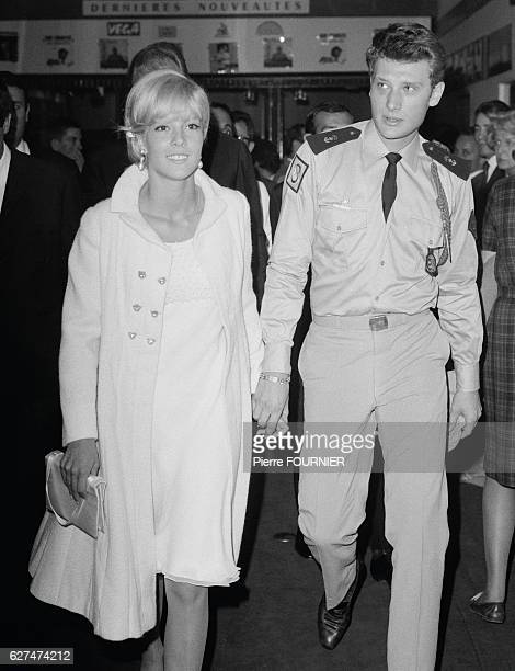 French singers Sylvie Vartan and Johnny Hallyday attend a Dalida and Claude Nougaro concert at the Olympia Hall in Paris