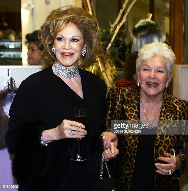 French singing legend Line Renaud appears with Phyllis McGuire of the singing group The McGuire Sisters during the presentation of Renaud's new line...