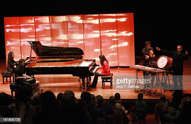 French sisters concert pianists Katia Labeque and Marielle Labeque perform with the Kalakan Trio on percussion Ravel's 'Bolero' arrangement for duo...
