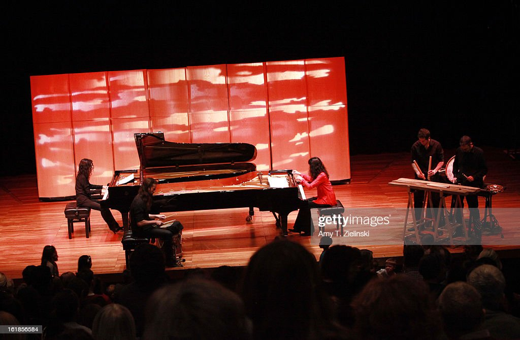 French sisters, concert pianists Katia Labeque and Marielle Labeque perform with the Kalakan Trio on percussion Ravel's 'Bolero' arrangement for duo piano as part of 'Imagine' family concerts programming at the Queen Elizabeth Hall on February 17, 2013 in London, England. Jamixel Bereau (L), Xan Errotabehere (C) and Thierry Biscary (R) form the Kalakan Trio.