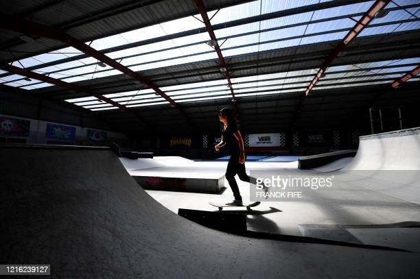 French skateboarder street category Charlotte Hym practices as she prepares for the qualifications for the Olympics Games at the Cosanostra skatepark...