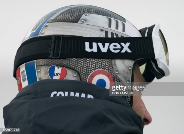 French ski racer Adrien Theaux wears a sticker on his helmet in honor of his teammate David Poisson during a downhill training run November 24 2017...