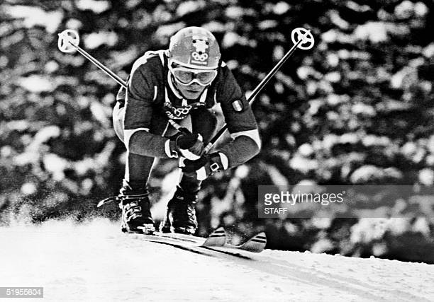 French skier Bernard Orcel tries to gather more speed during the men's downhill practice 04 February 1968 in Chamrousse near Grenoble during the...