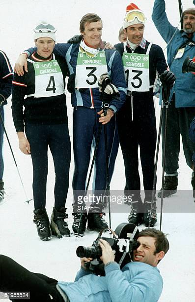 French skier JeanClaude Killy flanked by Austrian Heinrich Messner and Swiss Willy Favre smiles for photographers 12 February 1968 in Chamrousse near...