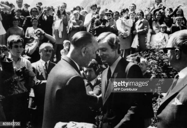 French skier JeanClaude Killy receives the Legion of Honor from the hands of MP Jacques Vendroux 04 August 1968 in Val d'Isère / AFP PHOTO /