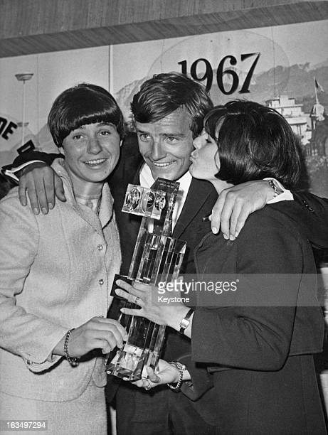 French skier JeanClaude Killy with the trophy after winning the Alpine Skiing World Cup EvianlesBains France 3rd May 1967 With him are French skiers...
