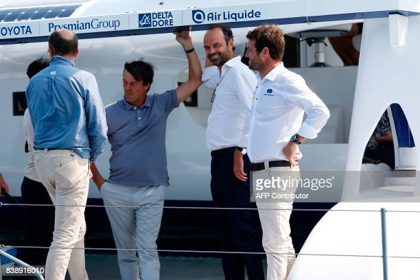 French skipper and project founder Victorien Erussard Prime Minister Edouard Philippe and Ecology Minister Nicolas Hulot stand onboard the selfenergy...