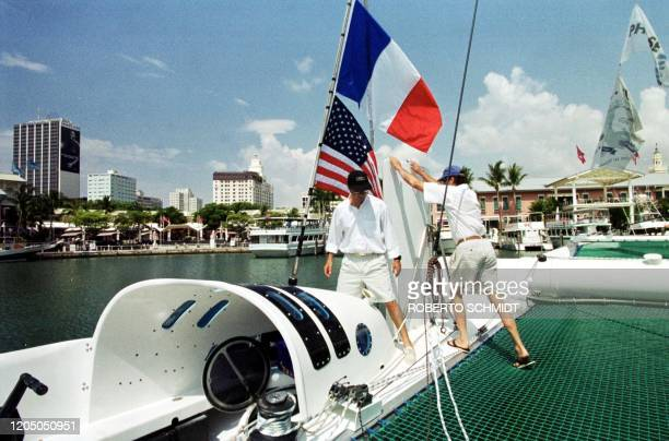 French skipper Bruno Peyron and his shipmate and coskipper Cam Lewis of the US walk aboard their 86 foot catamaran Explorer at a local marina in...