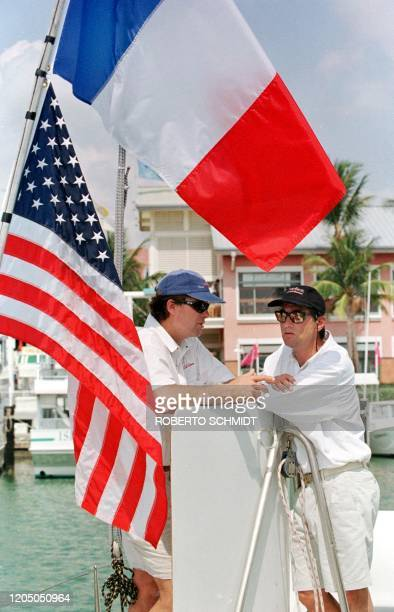 French skipper Bruno Peyron and his shipmate and coskipper Cam Lewis of the US speak aboard their 86foot catamaran Explorer during at a marina in...