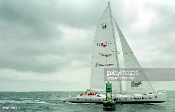French skipper Bruno Peyron and his US counterpart Cam Lewis along with a small crew sail their 86foot catamaran Explorer past the start line between...