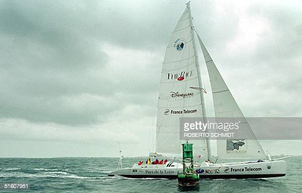 """French skipper Bruno Peyron and his US counterpart Cam Lewis along with a small crew sail their 86-foot catamaran """"Explorer"""" past the start line..."""