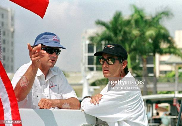 French skipper Bruno Peyron and his US counterpart Cam Lewis pose for photographers during a photo opportunity aboard their 86 foot catamaran...