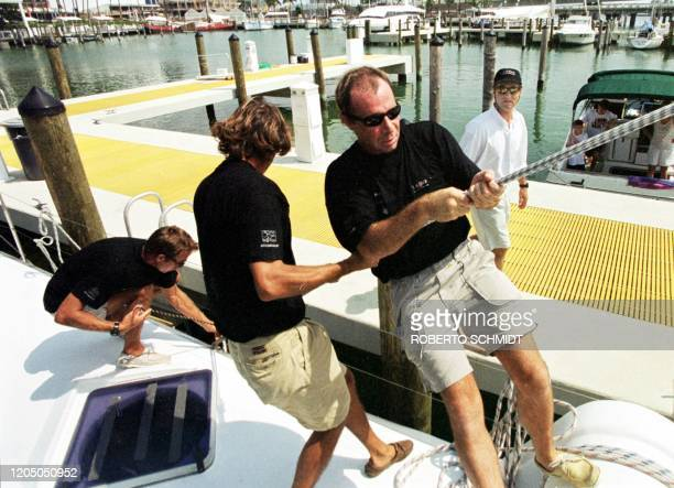"French skipper Bruno Peyron watches as part of his crew readies his 86-foot catamaran ""Explorer"" before leaving a local marina in downtown Miami 29..."