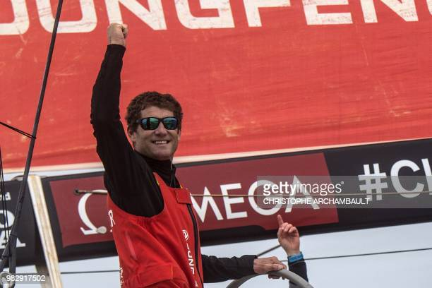 French skipper Charles Caudrelier of Dongfeng Race Team of China waves aboard after crossing the finish line and winning the Volvo Ocean Race in...
