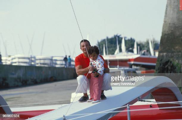 "French skipper Eric Tabarly and his daughter Marie aboard the ""Cote d'or II""."