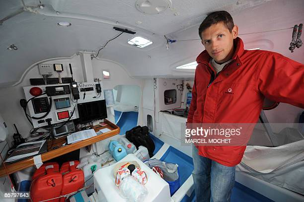 French skipper Erwan Tabarly poses in his monohull Athema on April 4 2009 at Le Palais harbour in BelleIleenMer island western France He will...