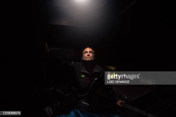 French skipper Fabrice Amedeo poses while sailing his Imoca 60 monohull Newrest - Arts et Fenetres during a training session, on June 26 off the...
