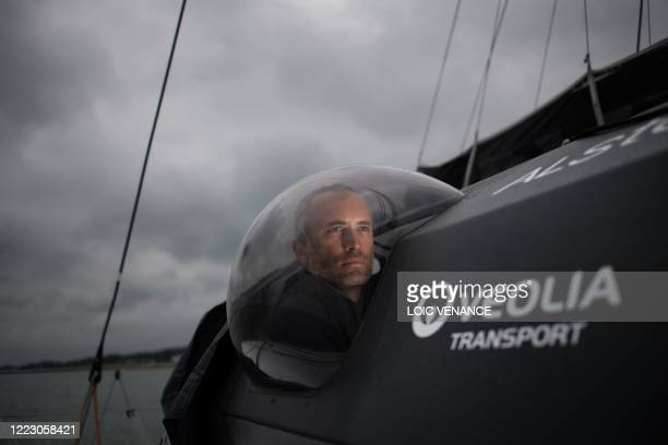 French skipper Fabrice Amedeo sails his Imoca 60 monohull Newrest - Arts et Fenetres during a training session, on June 26 off the coasts of La...