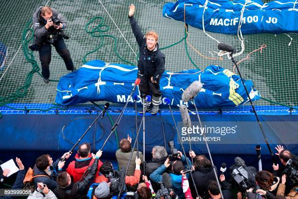 TOPSHOT French skipper Francois Gabart answers journalists' questions upon his arrival at the end of his solo around the world navigation on December...