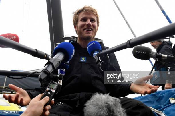 French skipper Francois Gabart answers journalists' questions upon his arrival at the end of his solo around the world navigation on December 17 2017...