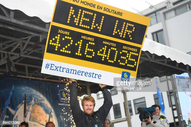 TOPSHOT French skipper Francois Gabart celebrates during a welcoming ceremony upon his arrival at the end of his solo around the world navigation on...