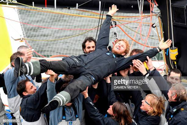 TOPSHOT French skipper Francois Gabart celebrates with his team upon his arrival at the end of his solo around the world navigation on December 17...