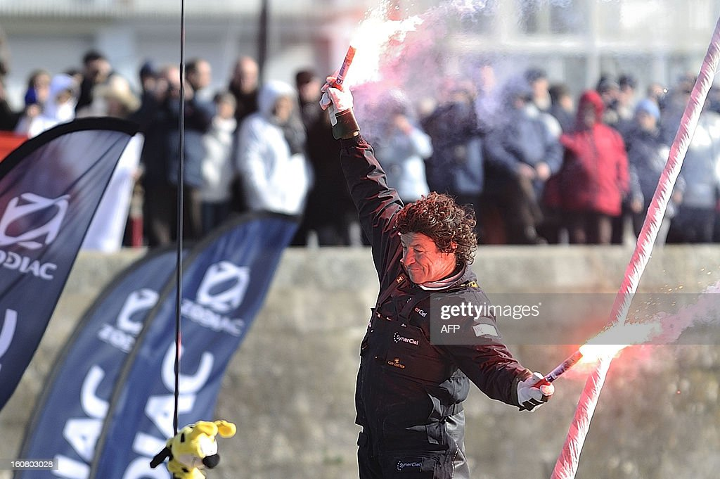 French skipper Jean Le Cam celebrates on his monohull 'SynerCiel' upon his arrival at the 7th edition of the Vendee Globe solo round-the-world race on February 6, 2013 in Les Sables d'Olonne, western France. Le Cam finished in 5th position after 88 days at sea.