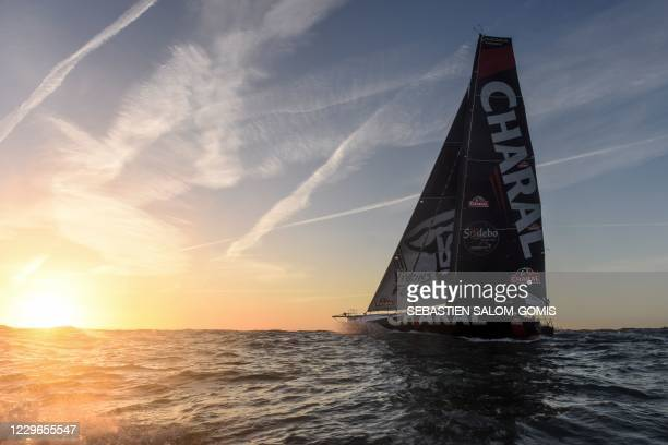 French skipper Jeremie Beyou leaves Les Sables-d'Olonne aboard his Imoca 60 monohull Charal after he was forced to U-turn back on November 12 to Les...