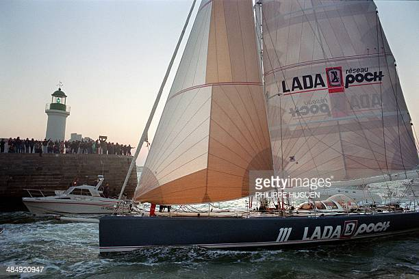 French skipper Loïck Peyron arrives on his monohull Lada Poch III in Les Sablesd'Olonne western France on March 17 as he finishes second in the first...