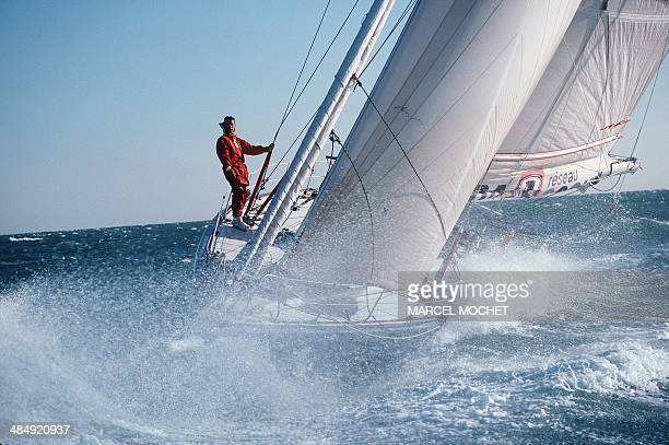 French skipper Loïck Peyron is seen onboard his Lada Poch monohull during a training session off Les Sablesd'Olonne western France on November 22...