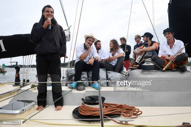 French skipper Marie Tabarly stands with her team on the deck of the PenDuick VI before the start of her sailing project Elemen'Terre project in...