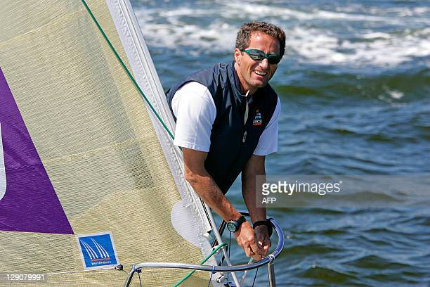 French skipper Michel Desjoyeaux takes the start of the 38th solo race Solitaire du Figaro 31 July 2007 off the coast of Ouistreham in Normandy...