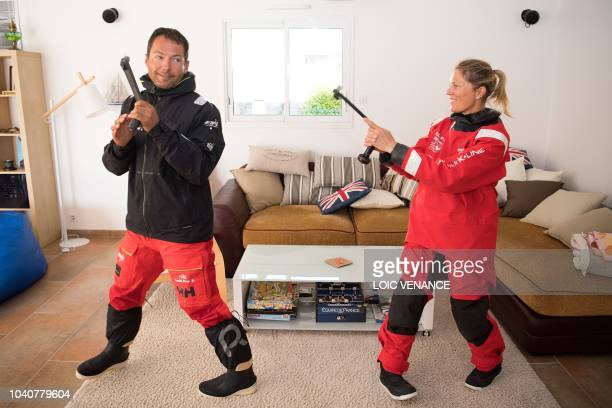 TOPSHOT French skipper Romain Attanasio and English skipper Samantha Davies husband and wife simulate a duel with winches in their house in Tregunc...