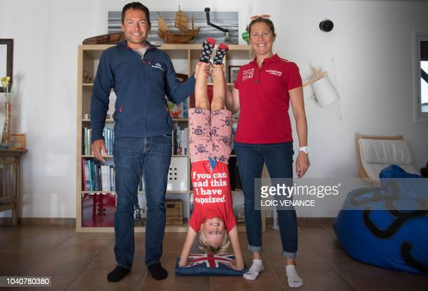 French skipper Romain Attanasio and English skipper Samantha Davies husband and wife pose with their son in their house in Tregunc western France on...