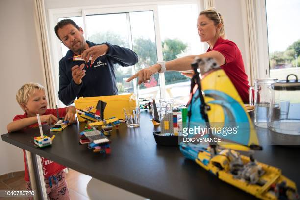 French skipper Romain Attanasio and English skipper Samantha Davies husband and wife play lego with their son in their house in Tregunc western...