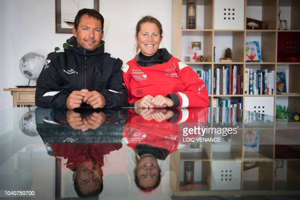 French skipper Romain Attanasio and his wife English skipper Samantha Davies pose in their house in Tregunc western France on September 25 2018...