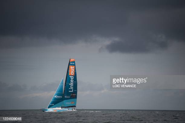 French skipper Thomas Ruyant sails his Imoca 60 monohull LinkedOut, on July 3 in Lorient, western France, to reach Les Sables-d'Olonne for the start...