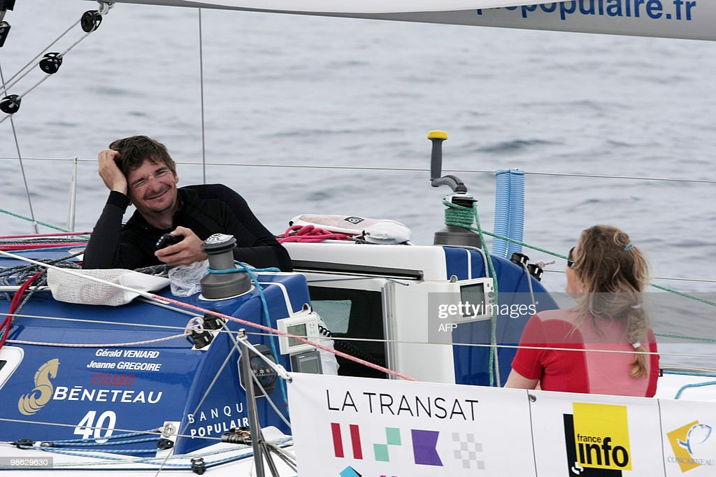 French skippers Jeanne Gregoire and Gerald Veniard sail off on their 'Banque Populaire' monohull on April 23, 2010, during the AG2R La Mondiale sailing race between Concarneau, western France, and Saint-Barthelemy (French West Indies). 25 boats started from Concarneau on April 18.