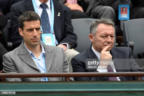 French slalom canoeist Tony Estanguet and France's junior minister for sports Thierry Braillard attend the women's final match between Spain's...