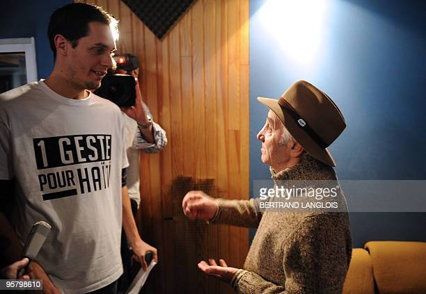 French Slam poet Grand Corps Malade listens to French singer Charles Aznavour before they record with a dozen of French rappers and pop stars a music...