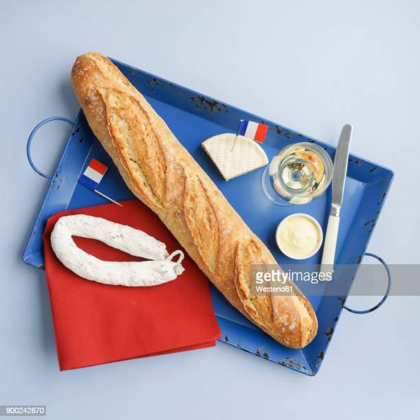 French snack with baguette , white wine, camembert and salami