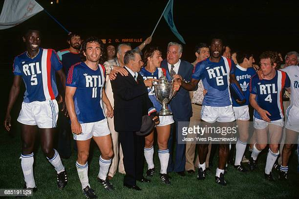 French soccer cup final for the 19751976 season Olympique de Marseille vs Olympique Lyonnais OM's players celebrate victory with trophy Marius Tresor