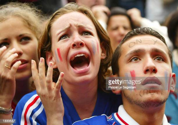 French soccer fans react as their team is defeated by Denmark 20 during the 2002 World Cup watched on a giant screen June 11 2002 in Paris France