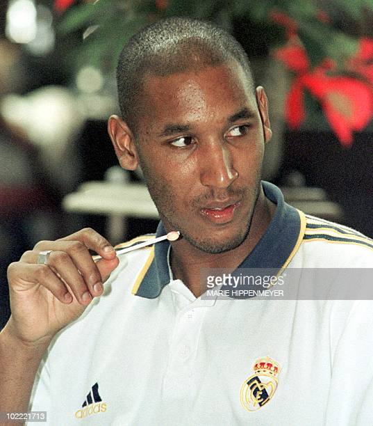 French soccer forward Nicolas Anelka of Real Madrid eats a lollypop in the lobby of the hotel where his team is staying in Sao Paulo Madrid 06...
