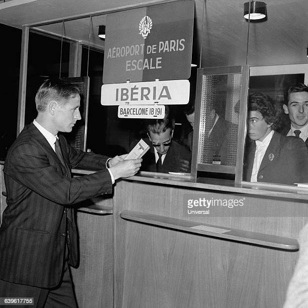 French soccer legend Raymond Kopa at the airport, leaving France to play with his new club, Real Madrid.